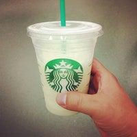 Photo taken at Starbucks by T V. on 5/5/2012