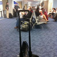 Photo taken at Gate B12 by Charly S. on 6/11/2012