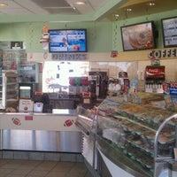 Photo taken at Krispy Kreme Doughnuts by Chris on 10/1/2011