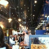 Photo taken at Intelligentsia Coffee & Tea by Nina S. on 12/10/2011