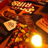 Photo taken at TGI Fridays by Alexander M. on 7/9/2012