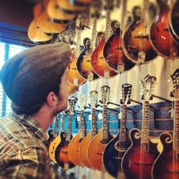 Photo taken at Gruhn Guitars by Evan S. on 7/11/2012