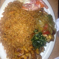 Photo taken at Trinity African Bar & Grill by Isaac D. on 8/7/2013