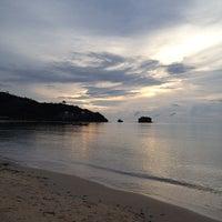 Photo taken at Nai Yang Beach by Ople K. on 10/24/2012