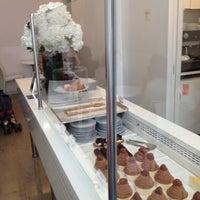 Photo taken at Lady M Cake Boutique by Tina K. on 4/26/2013