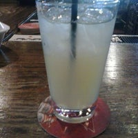 Photo taken at Bull Shed Bar & Grill by Jodie W. on 3/24/2013