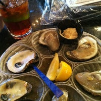 Photo taken at Desire Oyster Bar by Dana G. on 3/3/2013