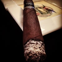 Photo taken at Jenuwine Cigar Lounge by Sean C. on 10/31/2014