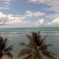 Photo taken at Praia Barra de São Miguel by Helio N. on 4/19/2013