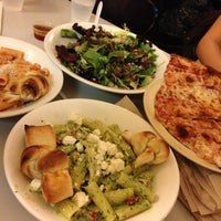 Photo taken at Regents Pizzeria by Soojin S. on 12/19/2012