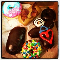 Photo taken at Voodoo Doughnut Tres by Amber S. on 6/8/2013