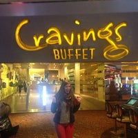 Photo taken at Cravings Buffet by Kate G. on 12/21/2012