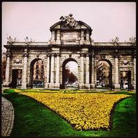 Photo taken at Alcalá Gate by Alexandre I. on 3/26/2013