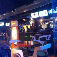 Photo taken at Underdoggs Sports Bar & Grill by Sanchit M. on 3/22/2013