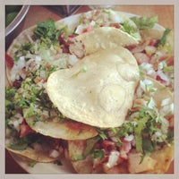 Photo taken at Tacos de Mexicaltzingo by Nino K. on 1/19/2013