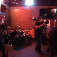 Photo taken at Ozzy's Sports Grill by Kris S. on 3/2/2014