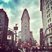 Photo taken at Flatiron Building by Masha A. on 5/27/2013