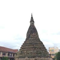Photo taken at That Dam Stupa by Pam C. on 6/30/2016