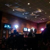 Photo taken at Smokey Bones Bar & Fire Grill by Abdullah A. on 5/3/2014
