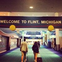 Photo taken at Bishop International Airport (FNT) by Ryan M. on 7/29/2013