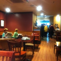 Photo taken at Caffé Nero by Peter J. on 12/27/2012