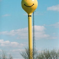 Photo taken at Smiley Face Water Tower by Jess S. on 9/20/2012