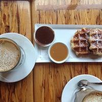 Photo taken at Medina Café by Sarah on 6/19/2014