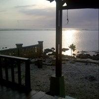 Photo taken at Pantai Ujung Genteng by Rusdianto M. on 11/8/2012