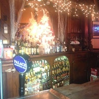 Photo taken at Palace Cafe by Aaron M. on 12/25/2012