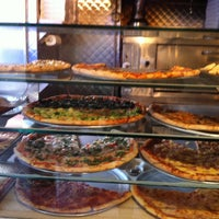 Photo taken at Perfecto Pizza by Leigh S. on 1/19/2013