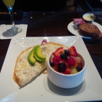Photo taken at Eclectic Fine Food & Spirits by Skar K. on 6/22/2014