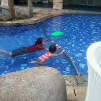 Photo taken at Poolside swiss-belhotel by Yusma A. on 5/29/2013