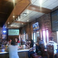 Photo taken at Champps Restaurant & Bar by Christopher B. on 10/21/2012