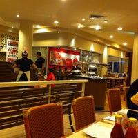 Photo taken at Pizza Hut by Adi P. on 4/12/2014