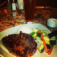 Photo taken at BJ's Restaurant and Brewhouse by Christopher J. on 4/6/2013