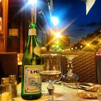 Photo taken at Pizza Momo by Scottie L. on 9/17/2014