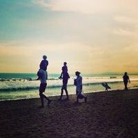 Photo taken at Pantai Kuta (Kuta Beach) by Arthur T. on 6/1/2013