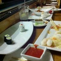 Photo taken at Sushi Train by Rora B. on 12/16/2012
