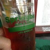 Photo taken at Springbok Bar & Grill by Tak U. on 3/16/2013