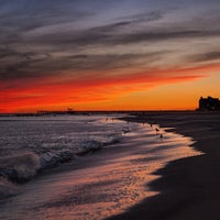 Photo taken at Ocean Parkway Beach by Aleksandr B. on 9/23/2014