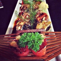 Photo taken at Lotus Japanese Fusion Cuisine by Andreia R. on 10/5/2013