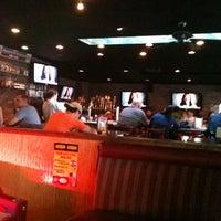 Photo taken at Handlebar Tavern by Gisele A. on 9/18/2012