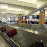 Photo taken at South Baggage Claim by Joel J. on 5/2/2013