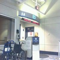 Photo taken at Gate E5 by Matthew A. on 10/19/2012