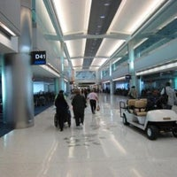 Photo taken at Concourse J by Emanuele on 4/2/2013