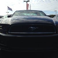 Photo taken at Bill Currie Ford (Show Room) by Gigi G. on 2/1/2014