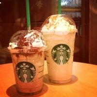 Photo taken at Starbucks by Евгения А. on 11/12/2012
