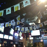 Photo taken at Hoops Sports Bar & Grill- Bremner by Wendy P. on 5/17/2016