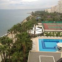 Photo taken at Mersin HiltonSA Hotel by Mustafa T. on 4/19/2013