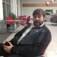 Photo taken at Quirk Nissan by Michael J. on 10/21/2013